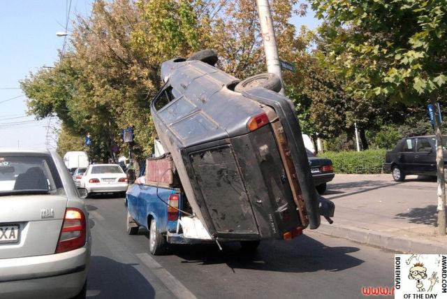 Pickup Truck Precariously Carrying A Van